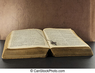 old bible book with silver cross