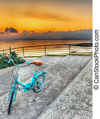 old bicycle at dusk in Alghero, Sardinia. hdr