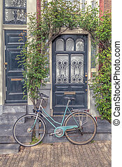 Bicycle in front of a House.