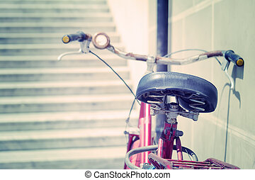 old bicycle leaning against a wall