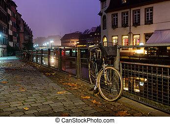 Old bicycle on city cobblestones