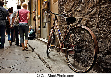 Old bicycle on the florence sreeet. Italy.