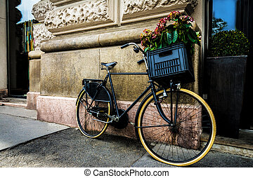 old bicycle standing against a wall