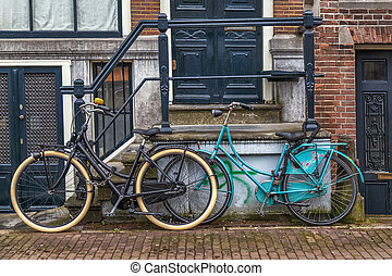 Bicycles in front of a House.