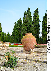 Old big clay pots with flowers, Balchik, Bulgaria