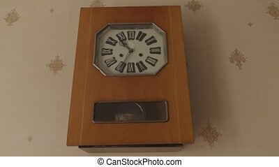 old big wall clock with a pendulum arrows go fast timelapse video.