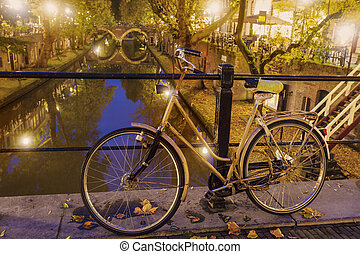 Old bike on the bridge in Utrecht. Utrecht, South Holland,...