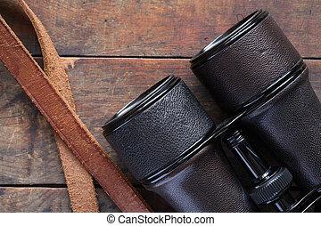 Old Binoculars On Wood