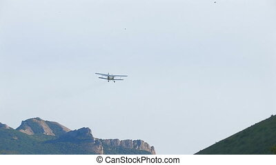 Old biplane flying in clear sky