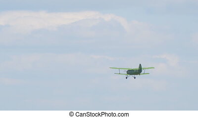 old biplane plane flies in sky - Old biplane plane flies in...