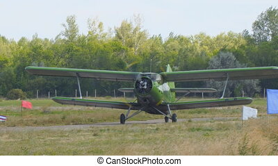 Old biplane plane on runway - Old biplane plane on the...
