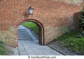 Old birck wall - entry to Cathedral in Frombork, Poland.