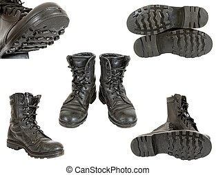 Old black army boots on white background
