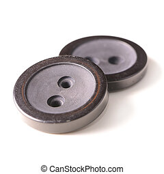 Old black buttons isolated on white background