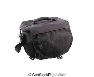 Old black camera bag on white background