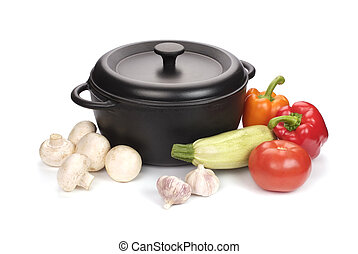 old black cast-iron cauldron with vegetables isolated on white