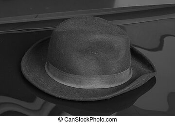 Old black hat on the black background.