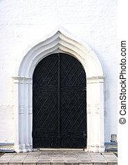 old black iron church door