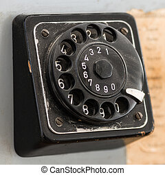 old black jog dial with numbers of retro telephone