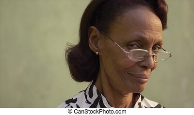 Senior people and confidence, portrait of proud african american woman with glasses smiling and looking at camera. Sequence