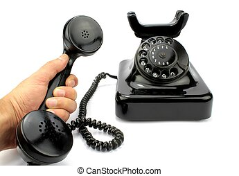 Old black phone and receiver in hand on white background.