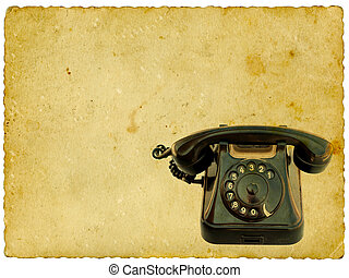 Old black phone on vintage background. Isolated on white.