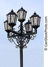 old black street lamp under blue sky