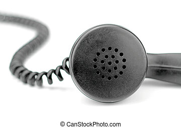 Old black telephone receiver with cord
