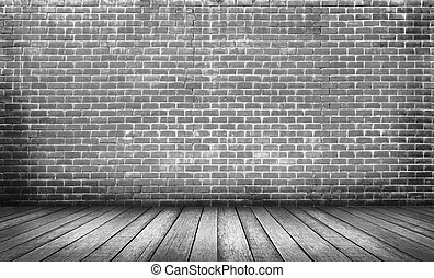 Old black wood floor with brick wall background