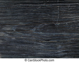 Old Black Wood Plank - Close-up of an old black wooden plank...