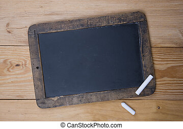 An old blank blackboard and white chalk