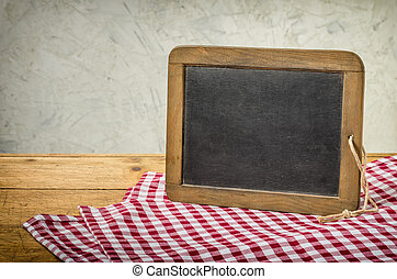 Old blackboard in a rustic setting