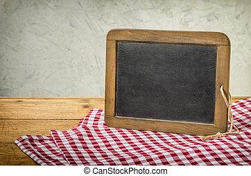Old blackboard in a rustic setting