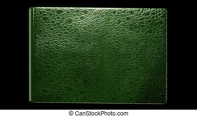 Old blank green book with flipping pages