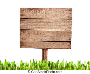 old blank wood road sign with grass