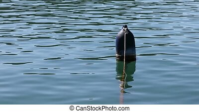 Old blue buoy - Blue buoy floating in peaceful Krka river.