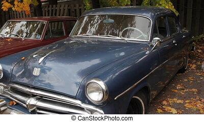 Old blue car. - An antique blue car sits in a parking lot....