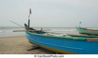 Old blue fisherman boat on the beach