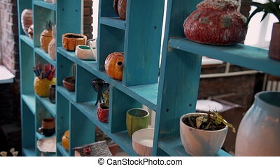 Old blue shelves with pottery, dishes and decorative vase -...
