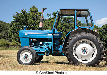 Old Blue Tractor - Old blue and white tractor standing idle...