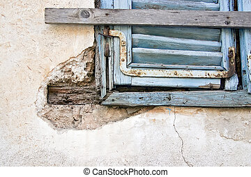 Old blue window on old wall