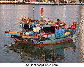 old blue wooden fishing boats in Da Nang