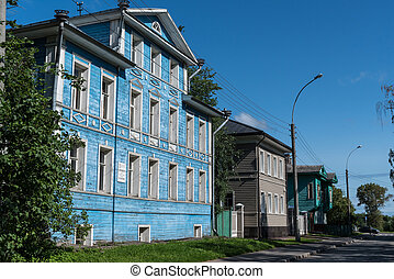 Old blue wooden house of actors named after actor Semenov A.V. with columns in Leningradskaya Street, 4, Vologda city, Russia