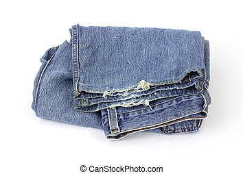 A pair of old bluejeans which are fraying on the bottom on a white background.