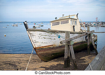 Old Boat - An old boat in Provincetown Harbor on Cape Cod in...