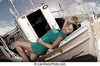 old boat and a beautiful girl