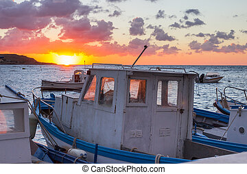 Old boat at sunset