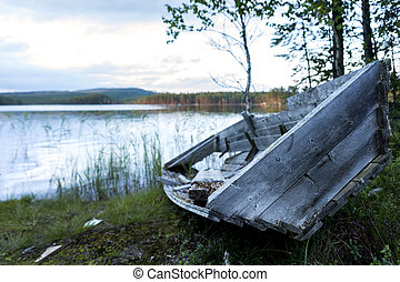old boat by lake