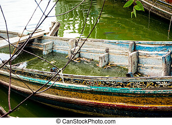 Boat decaying and drowned in lake