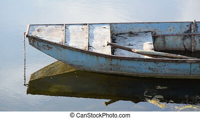 Old boat in calm water